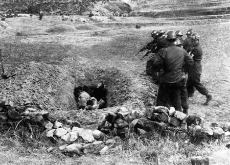 "U.S. military officers overseeing South Korean executions of civilians ""suspected of collaborating"" with the ""communists,"" near Taegu, south Korea, April 1951. Photo taken by U.S. Korean Military Advisory Group (KMAG)."
